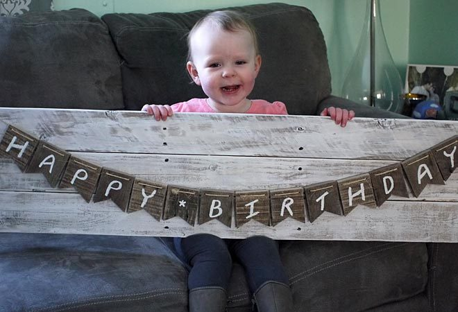 charlotte modeling the pallet wood bunting banner