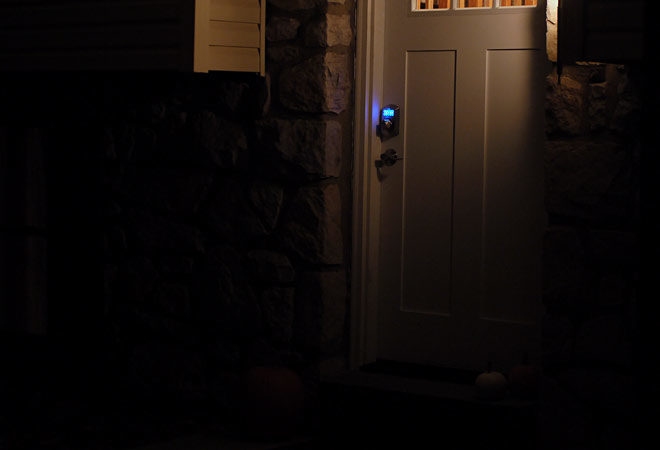 installed electronic deadbolt lit up at night