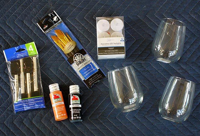 here are the supplies needed to make Jack-O-Lantern candle holders