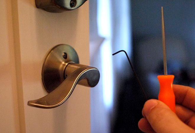 use a pick, hex wrench, or paperclip to flip a lever handle